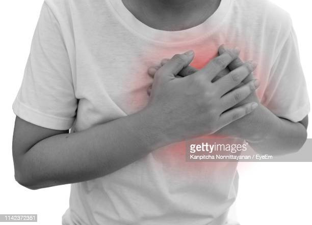 digitally generated image of man suffering from chest pain - heart attack stock pictures, royalty-free photos & images