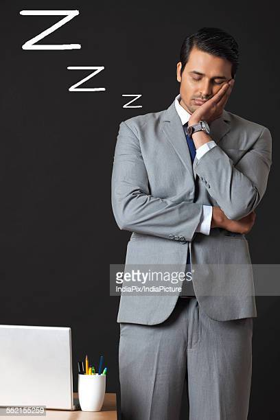 Digitally generated image of young businessman sleeping in office
