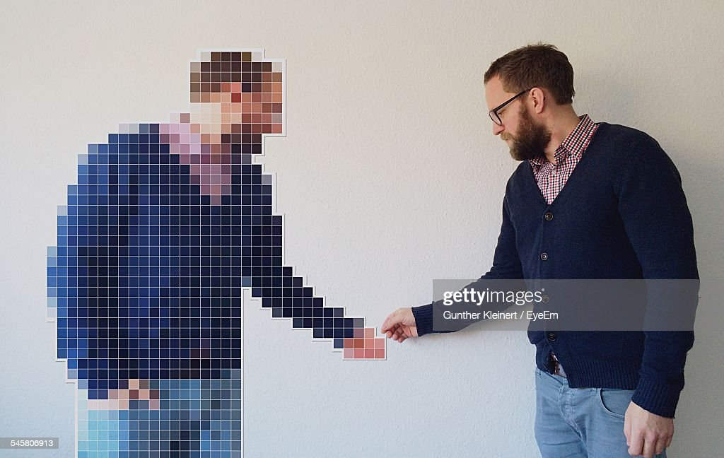 Digitally Generated Image On Man Shaking Hands With Himself At Home : Stock Photo