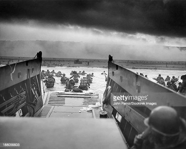 Digitally restored vintage World War II photo of American troops wading ashore on Omaha Beach during the D-Day invasion on June 6, 1944.