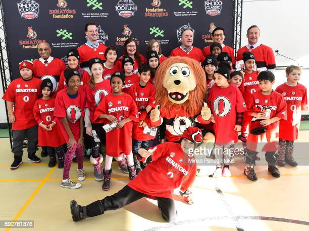 Dignitaries and children pose for a photo during the 2017 Scotiabank NHL100 Classic Legacy Project press conference at the Boys Girls Club Police...