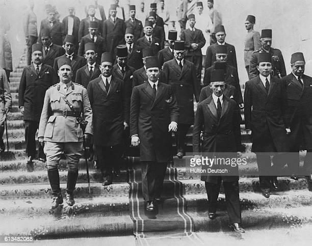 Dignitaries escort King Faruk I from the Ra's alTin Palace for his onward journey to Cairo