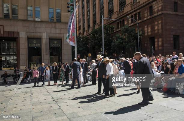 Dignitaries family and close friends inspect the permanent memorial honouring the lives of Tori Johnson and Katrina Dawson at Martin Place which...