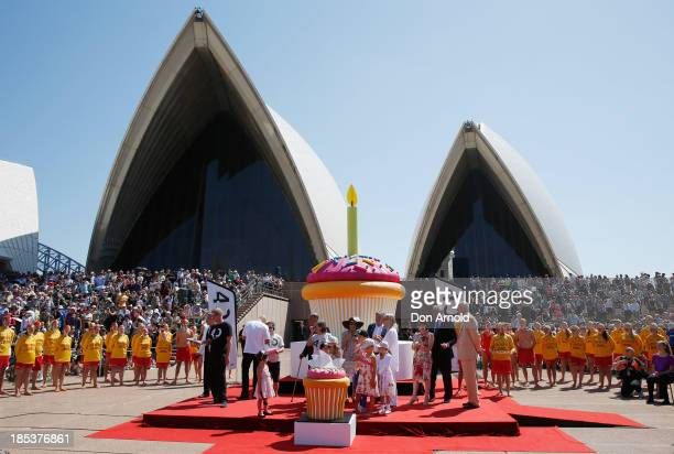 Dignitaries look on as a giant birthday cake is cut to celebrate the Sydney Opera House's 40th anniversary at Sydney Opera House on October 20 2013...