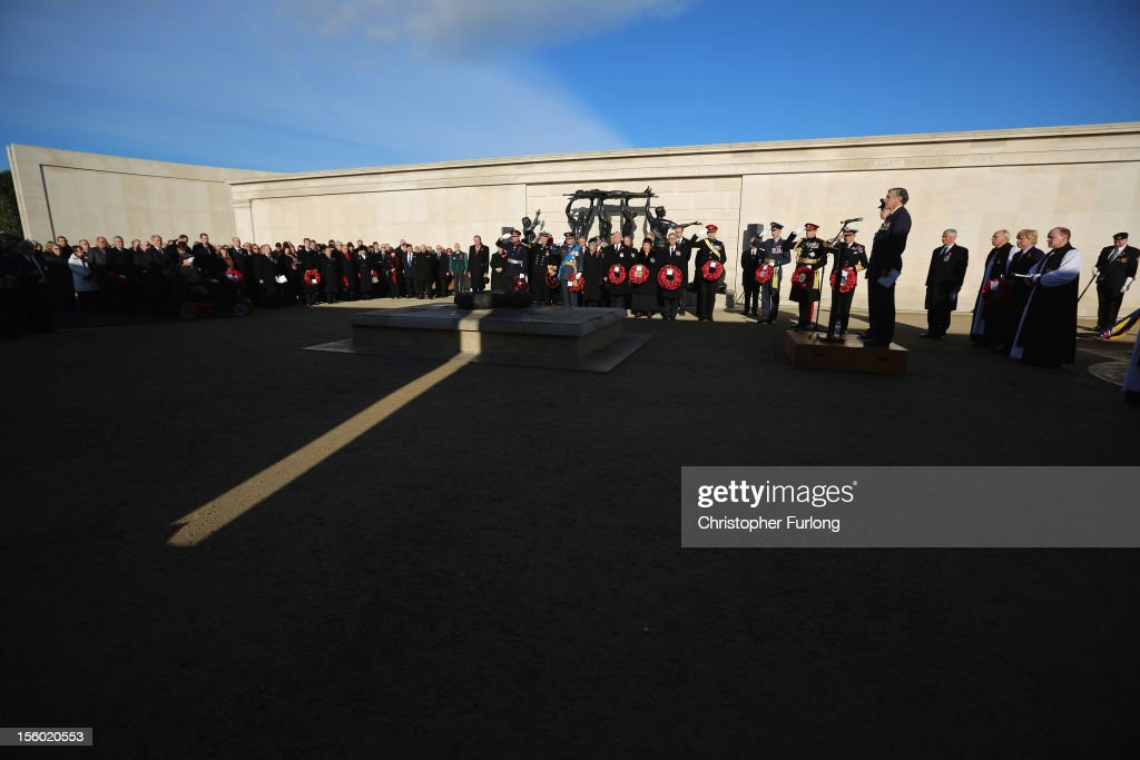 Dignitaries pay their respects as a shaft of sunlight falls on the central wreath of The Armed Forces Memorial on the 11th hour of the 11th day of the 11th month at The National Arboretum during the remembrance Service on November 11, 2012 in Alrewas, England. The Armed Forces Memorial, is the UK's tribute to the men and women who have been killed on duty or as a result of terrorist action since 1948. Their names are inscribed on the giant Portland stone walls. The obelisk is specifically dedicated to those who have died whilst in service. The Armed Forces Memorial has been designed to allow a shaft of sunlight to fall across the sculpted wreath on the central stone on Armistice Day at precisely 11:00am on the 11th day of the 11th month, the time when fighting formally stopped in World War I.