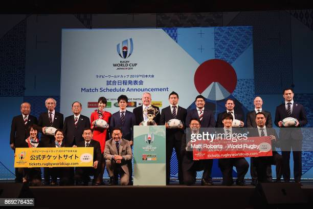 Dignitaries pose for a photograph on stage during the Rugby World Cup 2019 match schedule announcement at Grand Prince Hotel Shin Takanawa on...