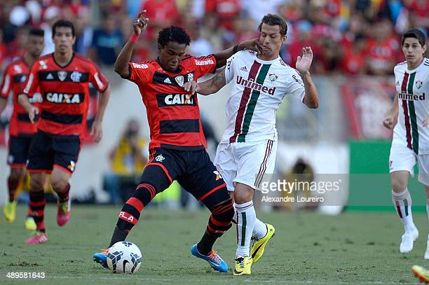 Diguinho of Fluminense battles for the ball with Luiz Antonio of Flamengo during the match between Fluminense and Flamengo as part of Brasileirao...