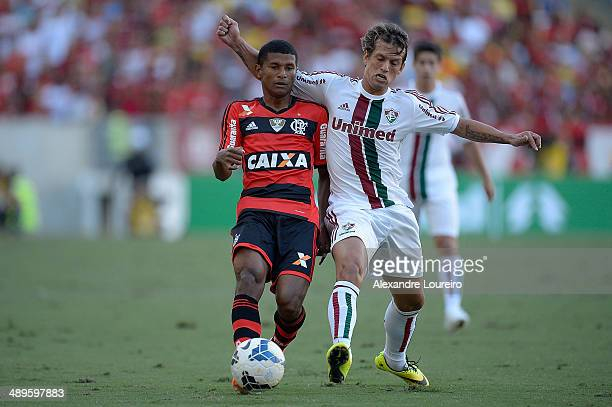 Diguinho of Fluminense battles for the ball with Marcio Araujo of Flamengo during the match between Fluminense and FlamengoÊ as part of Brasileirao...
