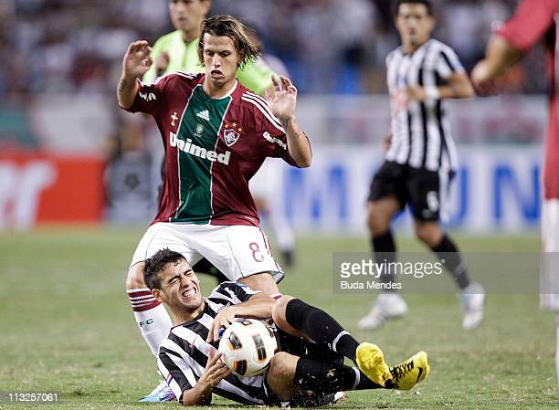 Diguinho of Fluminense struggles for the ball with Nunez of Libertad during a match as part of Libertadores Cup 2011 at Engenhao stadium on April 23...