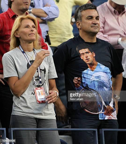 Dijana Djokovic and Srdjan Djokovic, parents of Novak Djokovic, watch play between Novak Djokovic of Serbia and Roger Federer of Switzerland during...