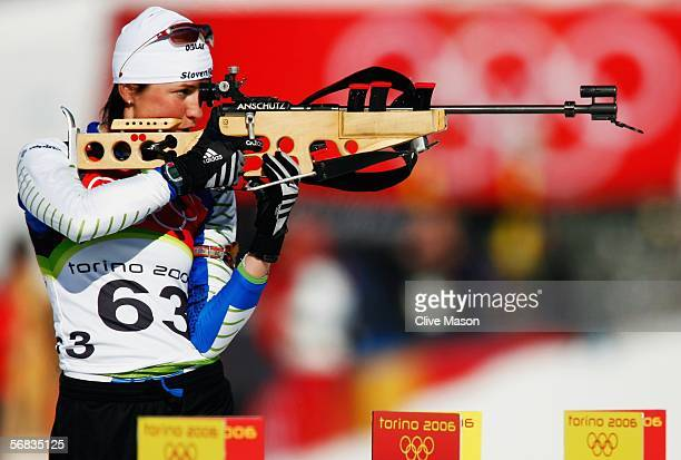 Dijana Grudicek of Slovenia shoots during the Womens Biathlon 15km Individual Final on Day 3 of the 2006 Turin Winter Olympic Games on February 13...