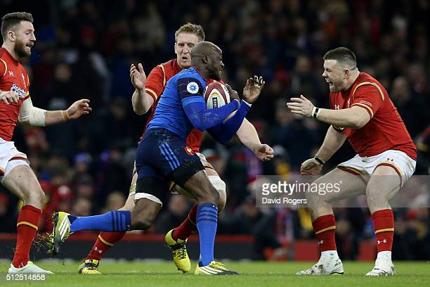 Dijbril Camara of France is tackled by Bradley Davies and Rob Evans of Wales during the RBS Six Nations match between Wales and France at the...