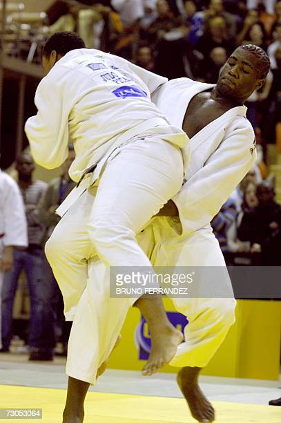 Teddy Riner fights with Cedric Mendeuf during their - 100 Kg Judo French championship fight, 20 January 2007 at the Palais des Sports in Dijon. AFP...