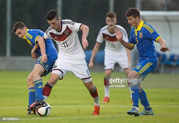 Dijon Ramaj of Germany challenges Yevhen smyrnyy of Ukraine during the Under 18 International Friendly match between Ukraine and Germany on December...