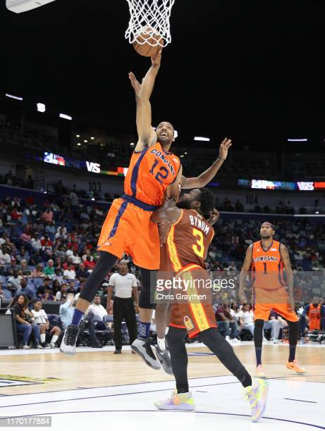 Dijon Thompson of 3's Company drives the ball to the basket as Will Bynum of Bivouac defends during the BIG3 Playoffs at Smoothie King Center on...