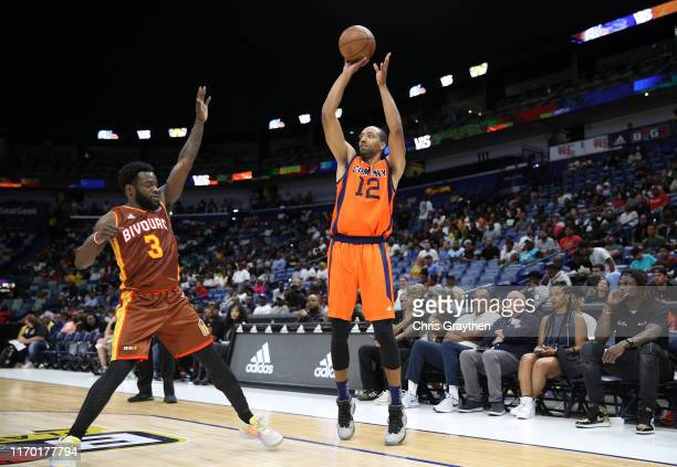 Dijon Thompson of 3's Company takes a shot as Will Bynum of Bivouac defends during the BIG3 Playoffs at Smoothie King Center on August 25, 2019 in...