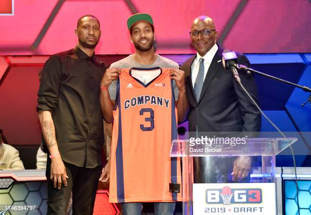 Dijon Thompson poses with 3's Company captain DerMarr Johnson and BIG3 Commissioner Clyde Drexler after being drafted at by the 3's Company in the...