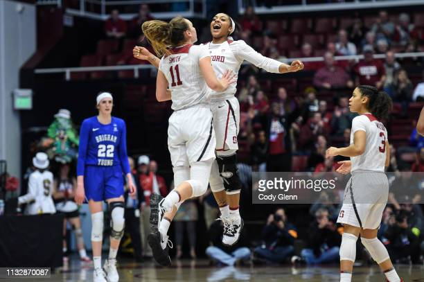 Dijonai Carrington and Alanna Smith of the Stanford Cardinal celebrate a Smith three-pointer against the BYU Cougars during the second round of the...