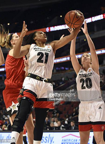 DiJonai Carrington Sabrina Ionescu of the West team go for a rebound against the East team during the 2016 McDonalds's All American Game on March 30,...
