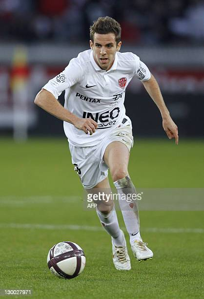 Dijon's Benjamin Corgnet runs behind the ball during the French L1 football match PSG vs Dijon on October 23 2011 at the Parc des Princes in Paris...