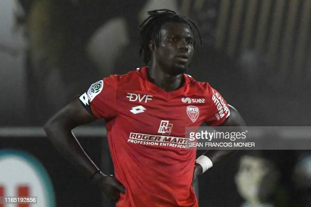 Dijon's Bissau-Guinean forward Mama Balde reacts after loosing the French L1 football match between SCO Angers and DFCO Dijon, on August 31 at...