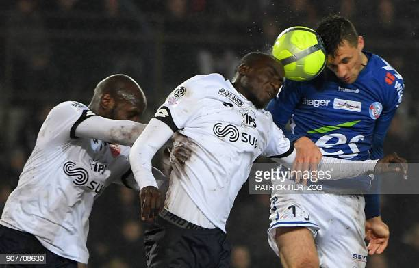Dijon's Cap Verdean forward Julio Tavares and French defender Cedric Yambere vie with Strasbourg's French forward Jeremy Blayac during the French...