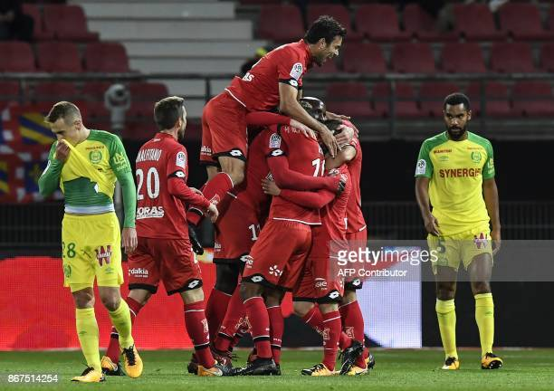 Dijon's Cap Verdian forward Julio Tavares is congratuled by teammates after scoring during the French L1 football match between Dijon and FC Nantes...