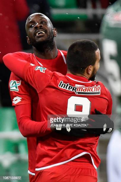 Dijon's Cape Verdean forward Julio Tavares celebrates with Dijon's Tunisian forward Naim Sliti after Dijon scored a goal during the French Cup round...