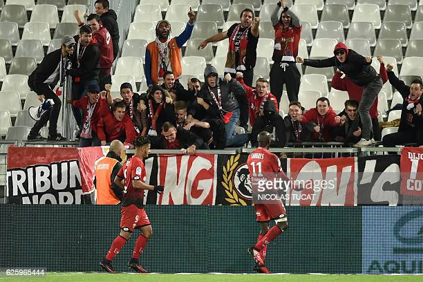 Dijon's Cape Verdean forward Julio Tavares celebrates with fans after scoring a goal during the French L1 football match between Bordeaux and Dijon...