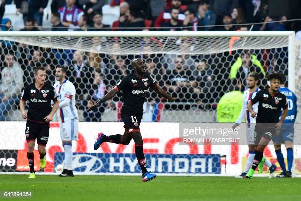 Dijon's Cape Verdean-French forward Julio Tavares celebrates after scoring a goal during the French L1 football match between Olympique Lyonnais and...