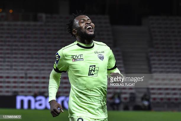 Dijon's Congolese defender Glody Ngonda celebrates after scoring a goal during the French L1 football match between Nice and Dijon at The Allianz...