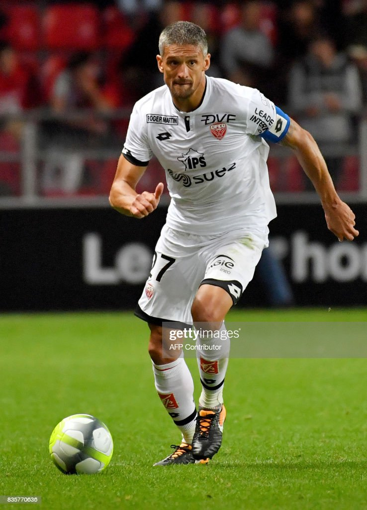 Dijon's French defender Cedric Varrault controls the ball during the French L1 football match Rennes vs Dijon at the Roazhon Park stadium in Rennes, western France, on August 19, 2017. /