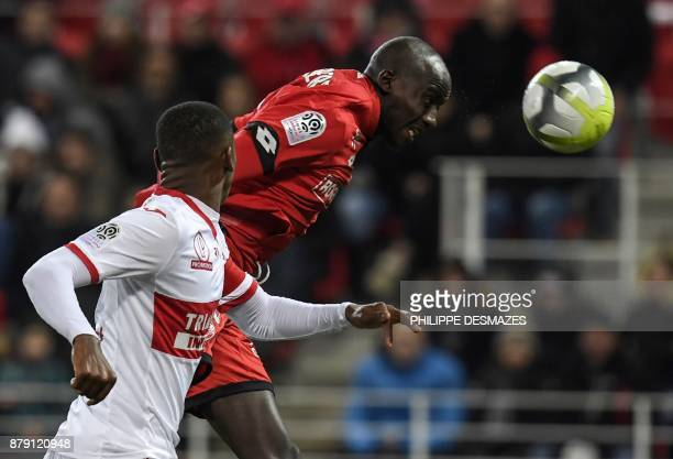 Dijon's French defender Cedric Yambere vies with Toulouse's French defender Issa Diop during the French L1 football match between Dijon and Toulouse...
