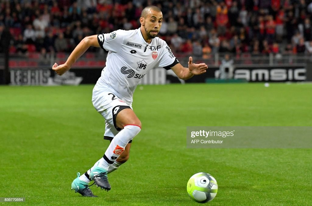 Dijon's French defender Fouad Chafik controls the ball during the French L1 football match Rennes vs Dijon at the Roazhon Park stadium in Rennes, western France, on August 19, 2017. /