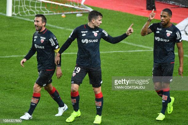 Dijon's French defender Mickael Alphonse celebrates with teammates after scoring a goal during the French L1 football match AS Monaco FC vs Dijon FCO...