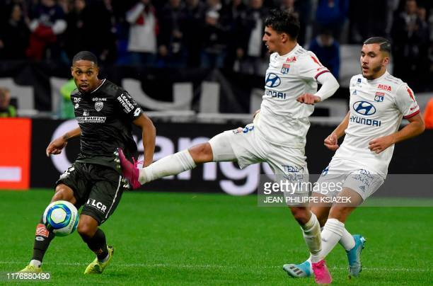 Dijon's French defender Mickael Alphonse challenges Lyon's French midfielder Houssem Aouar during the French L1 football match between Lyon and...