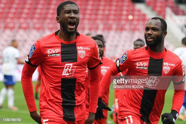Dijons French defender Senou Coulibaly celebrates with Dijon's Senegalese forward Moussa Konate after scoring a goal during the French L1 football...