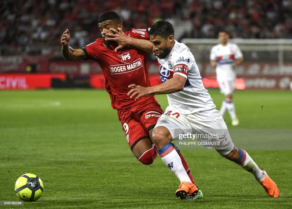 Dijon's French defender Valentin Rosier (L) vies with Lyon's French midfielder Nabil Fekir (R) during the French L1 football match between Dijon FCO and Olympique Lyonnais, on April 20, 2018, at the Gaston Gérard Stadium in Dijon, central France.