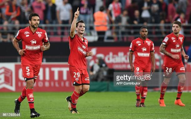 Dijon's French forward Benjamin Jeannot celebrates his goal during the French L1 football match between Dijon and Paris SaintGermain at the Gaston...