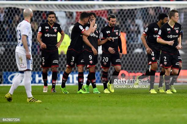 Dijon's French forward Lois Diony celebrates with teammates after scoring a goal during the French L1 football match between Olympique Lyonnais and...