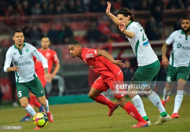 Dijon's French forward Wesley Said vies with SaintEtienne's Serbian defender Neven Subotic during the French L1 football match between Dijon and...