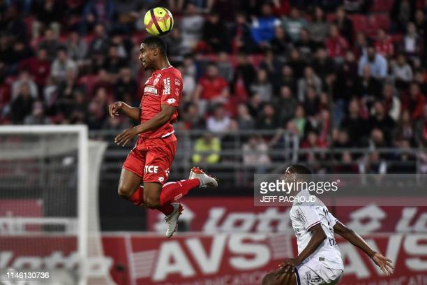 Dijon's French forward Wesley Said vies with Toulouse's French defender Bafode Diakite during the French L1 football match between Dijon and Toulouse...