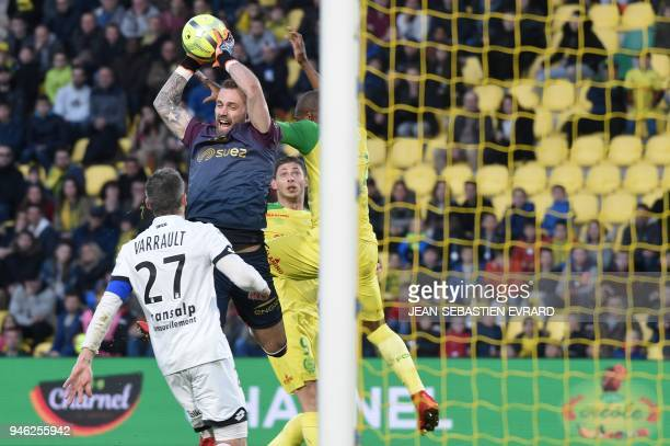 Dijon's French goalkeeper Baptiste Reynet catches the ball during the French L1 football match between Nantes and Dijon on April 14 at the Beaujoire...