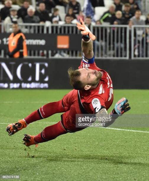Dijon's French goalkeeper Baptiste Reynet jumps to catch the ball during the French L1 football match between FC Girondins de Bordeaux and Dijon FCO...