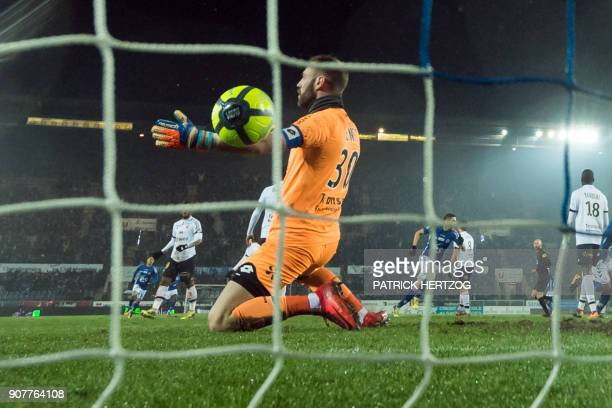 Dijon's French goalkeeper Baptiste Reynet reacts after Strasbourg's team scored a goal during the French L1 football match between Strasbourg and...