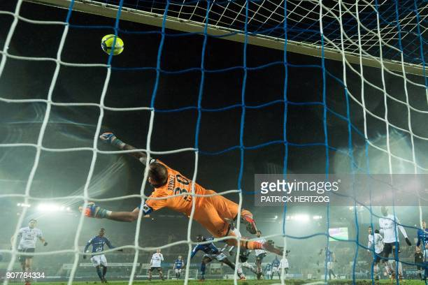 Dijon's French goalkeeper Baptiste Reynet tries to catch the ball during the French L1 football match between Strasbourg and Dijon on January 20 2018...
