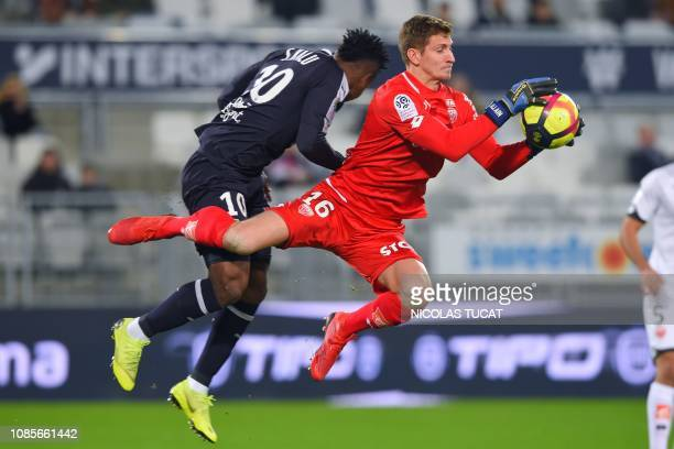 Dijon's French goalkeeper Bobby Allain vies with Bordeaux's Nigerian forward Samuel Kalu during the French L1 football match between Bordeaux and...