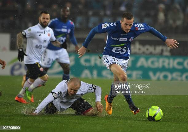 Dijon's French midfielder Florent Balmont vies with Strasbourg's French midfielder Dimitri Lienard during the French Ligue 1 football match between...