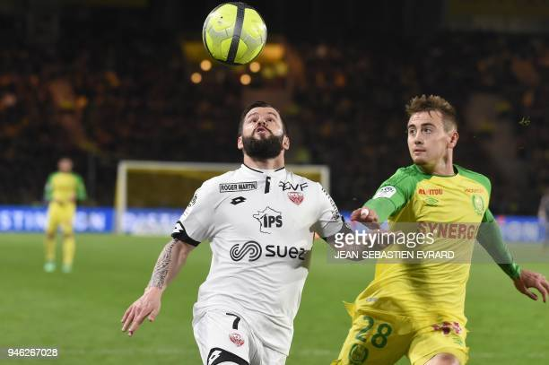 Dijon's French midfielder Frederic Sammaritano vies with Nantes' French midfielder Valentin Rongier during the French L1 football match between...