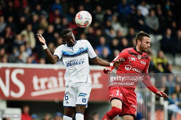 Dijon's French midfielder Jordan Marie vies with Auxerre's French midfielder Brahim Konate during the L2 football match Auxerre vs Dijon on April 23...